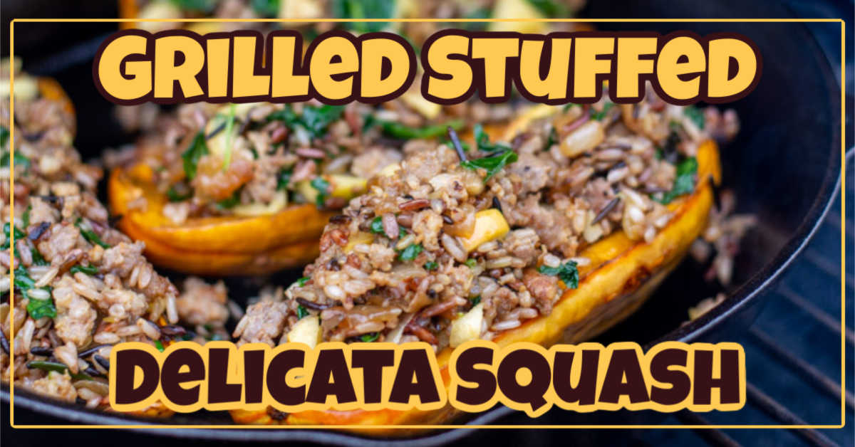 stuffed delicata squash in a cast iron skillet on the grill. It is stuffed with sausage, wild rice, spinach and apples
