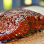 bright red salmon steak grilled with hickory