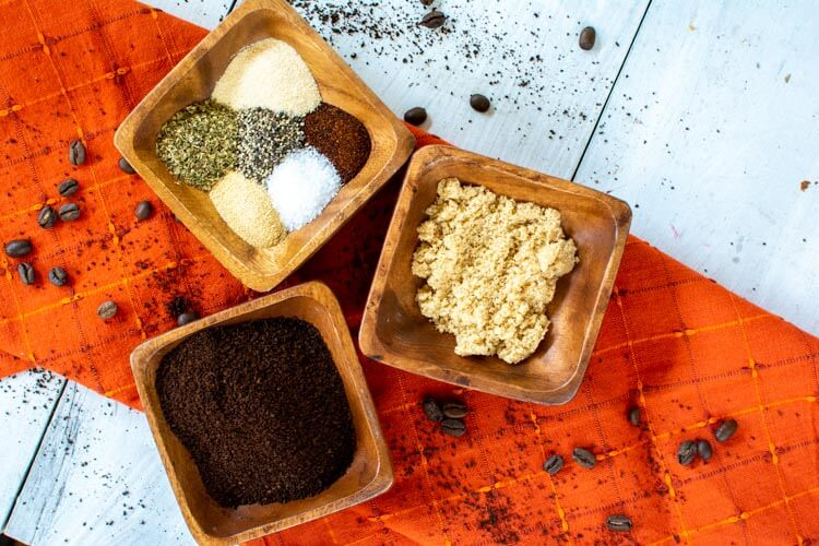 Three wooden containers with spices and seasonings to make this java rub