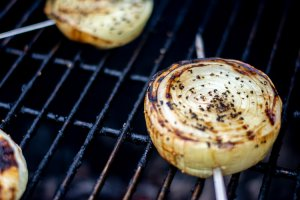 this onion is grilled through, and is golden brown. it is ready to be removed from the grill