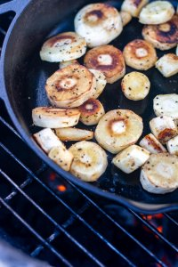 golden brown sliced and peeled parsnips on the grill