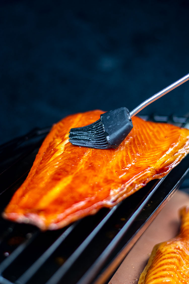 basting the smoked salmon with honey to harden the flesh and lock in the juices