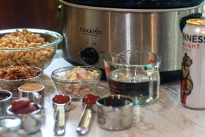 Guinness beer and the other ingredients in front of the crock pot