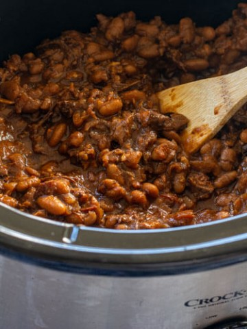 The baked beans thickened in the slow cooker after a long day of cooking
