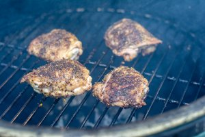 grilled chicken thighs with seasoning on the big green egg