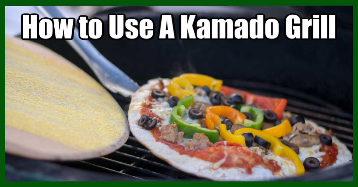 pulling a grilled pizza from the Kamado grill with a pizza peel