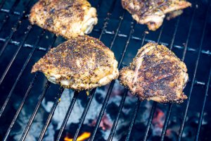 grilled chicken thighs over glowing coals