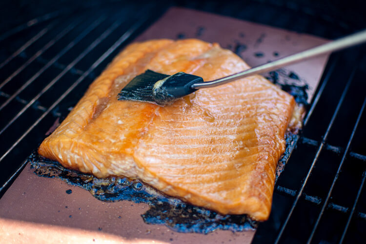 brushing a brown sugar and lemon glaze on the salmon fillet and the copper grilling mat. The sweet mixture won't stick to the mat