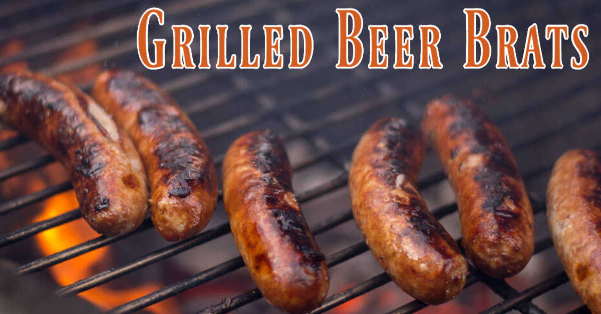 beer brats over an open flame on the grill being seared to perfection