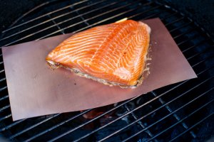 grilled salmon on a copper mat on the grate. Nothing sticks to the copper mat