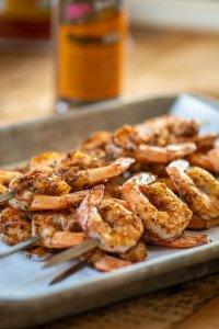 skewers of grilled shrimp on a sheet pan