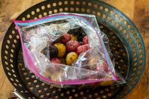 baby medley rainbow potatoes in a ziplock bag with olive oil salt and pepper