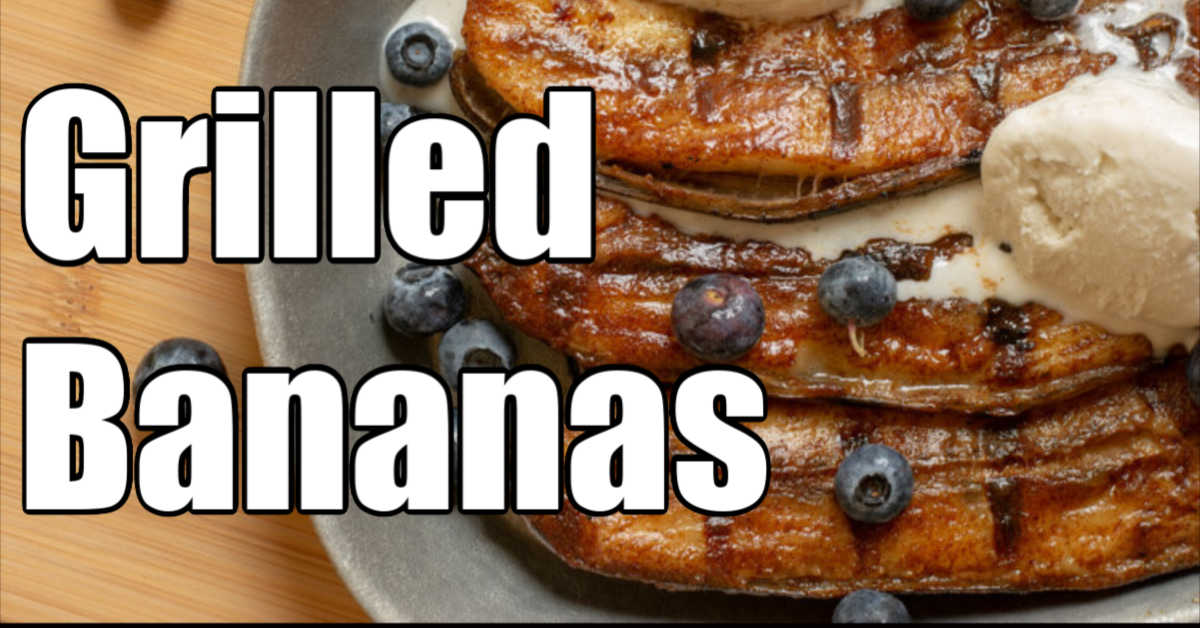 grilled bananas with vanilla ice cream melting on top and sprinkled with blueberries