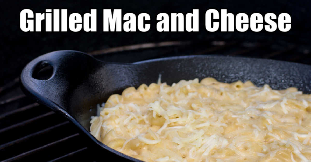 macaroni and cheese in a cast iron skillet on the grill