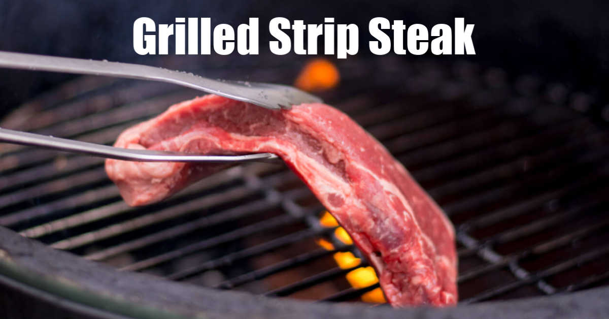 strip steak going on the grill with the direct heat flames in the background