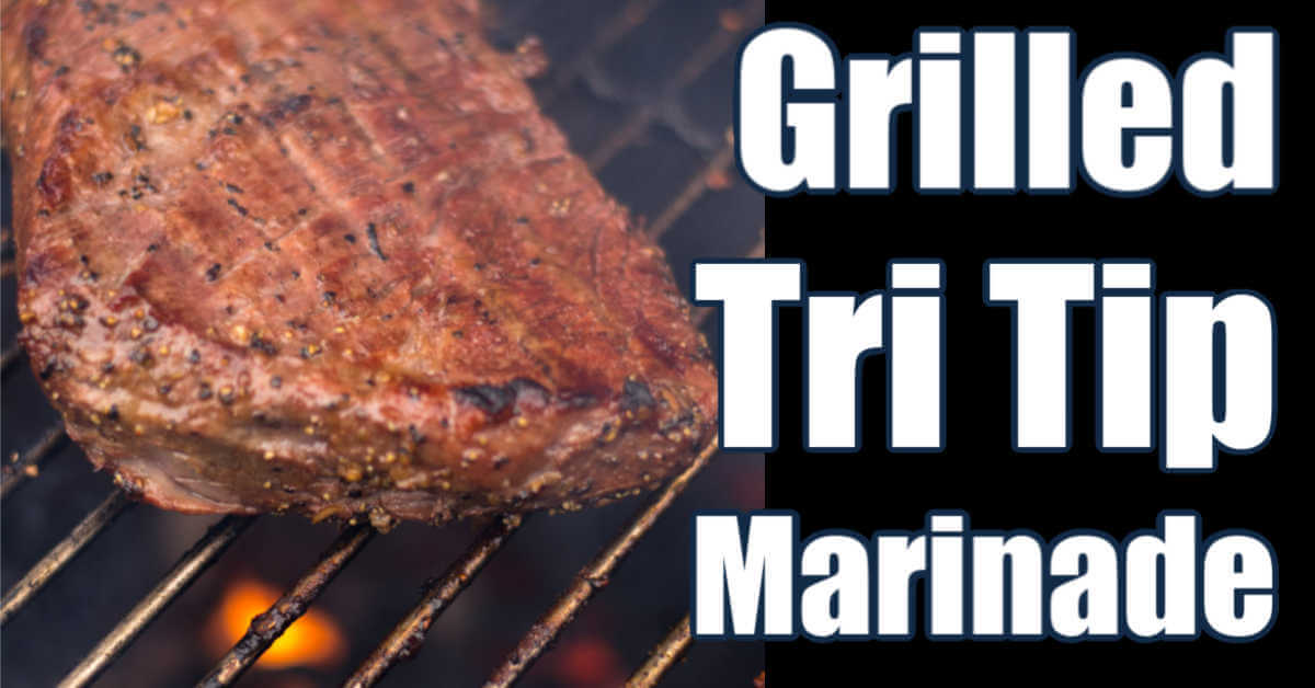 tri tip on the grill with a flame underneath