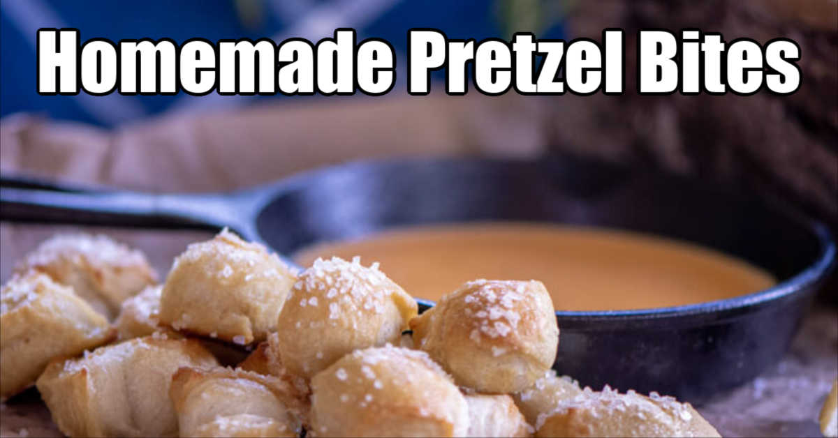 soft homemade pretzel bites stacked in front of a beer and cheese dip