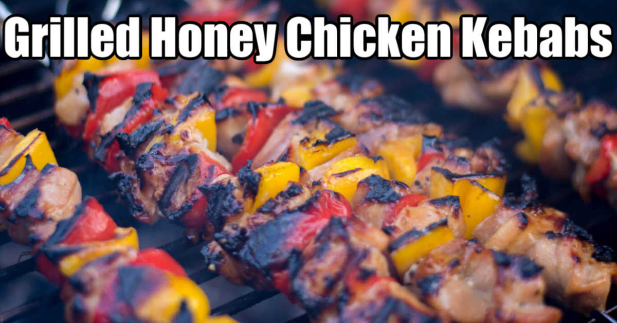 grilled honey chicken kebabs on the grill with a great char and colorful peppers