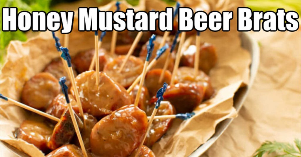 pile of slice beer brats in a honey mustard sauce with toothpicks.