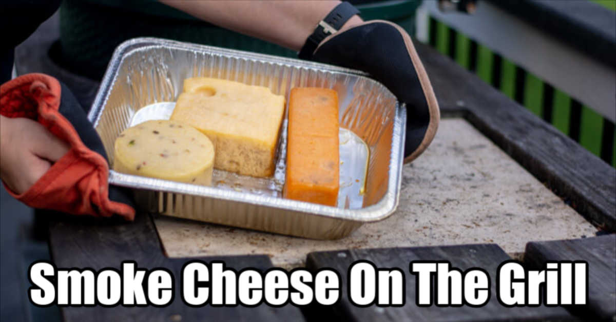 holding the disposable tray with blocks of cheese at the grilling table