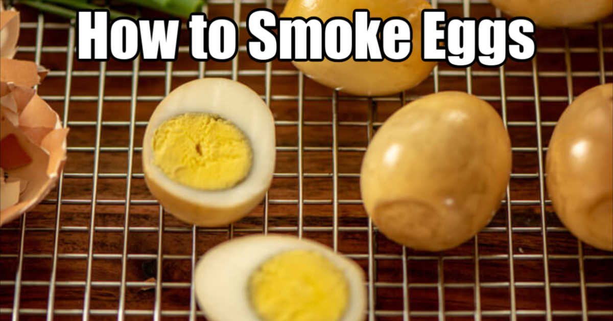 several hard boiled eggs on a cooling rack with the smoky brown coloring