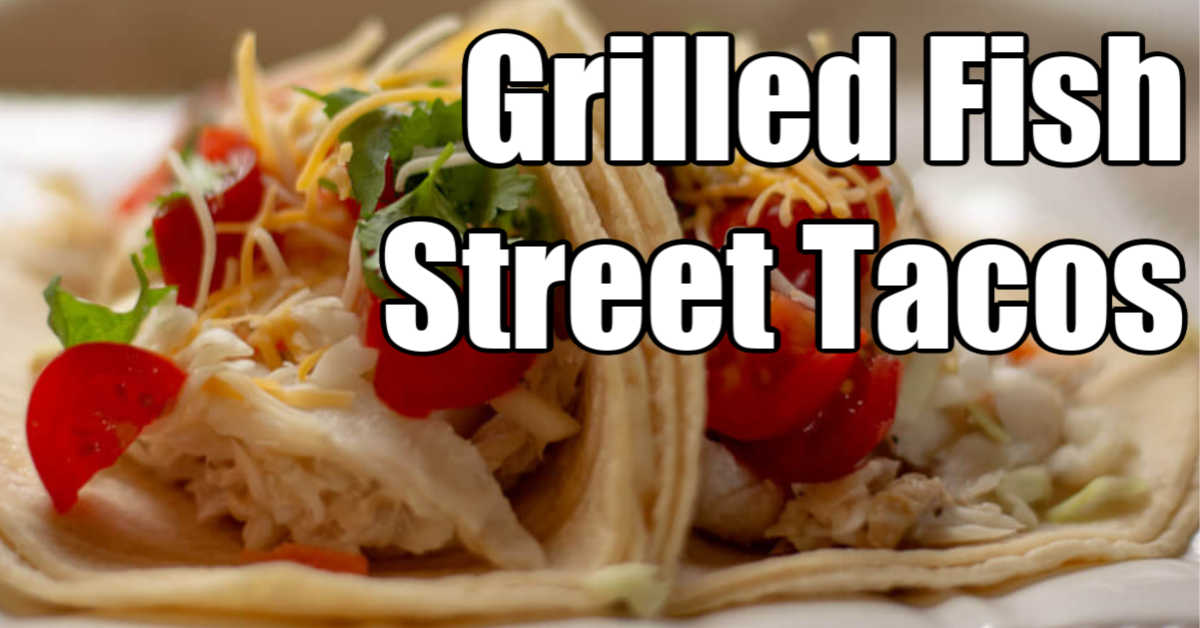 two grilled fish tacos with fresh tomatoes