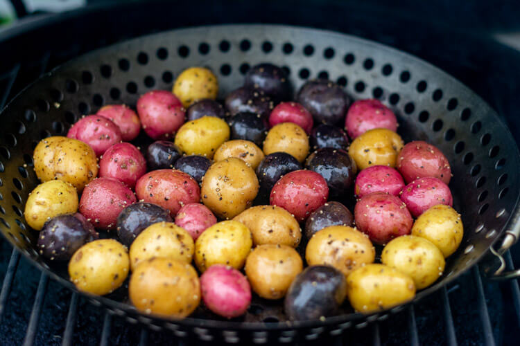 Colorful Baby Potatoes on a vegetable basket on the grill ready for a good smoke