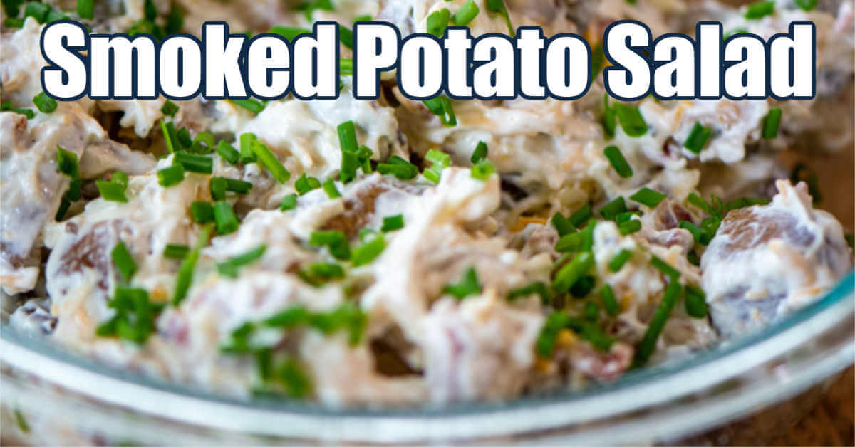 bowl of smoked potato salad topped with fresh green chives