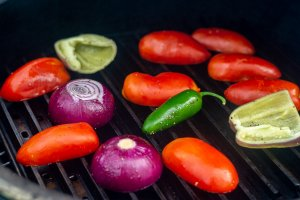 roma tomatoes, onions, peppers, jalapeños, and peppers on the grill