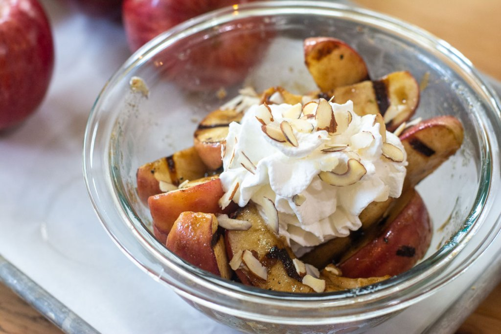bowl of grilled apples for serving with whipped cream