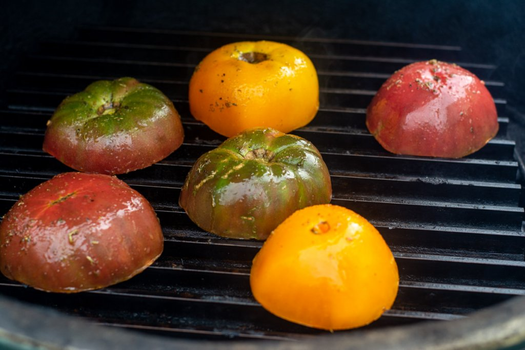tomatoes cut in half face down on the grill