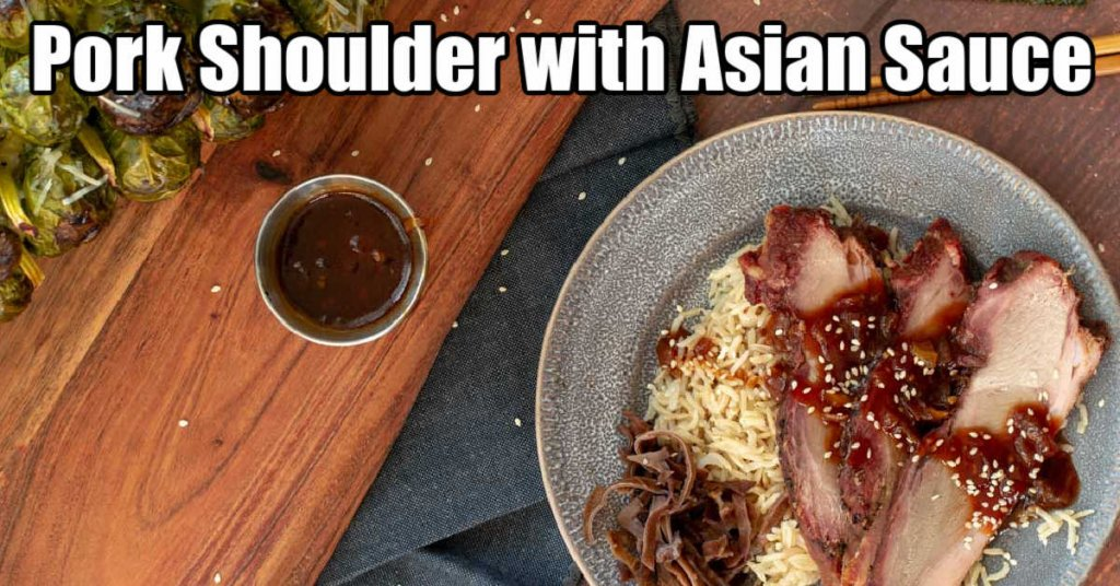 plate of pork shoulder slices with an asian sauce over a bed of basmati rice