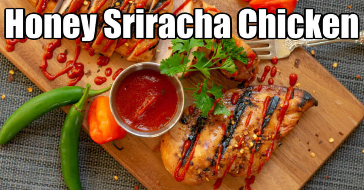 Cutting board with grilled chicken covered in a honey sriracha sauce and plated with peppers