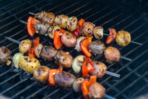 After Grilling, the potatoes are crispy and there are char marks on the skewers