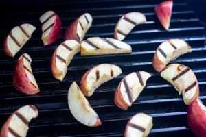 apple slices on the grill grate with beautiful char marks