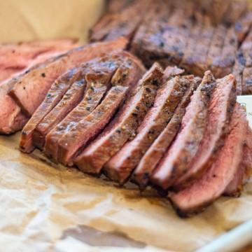 sliced ranch steak on butcher paper
