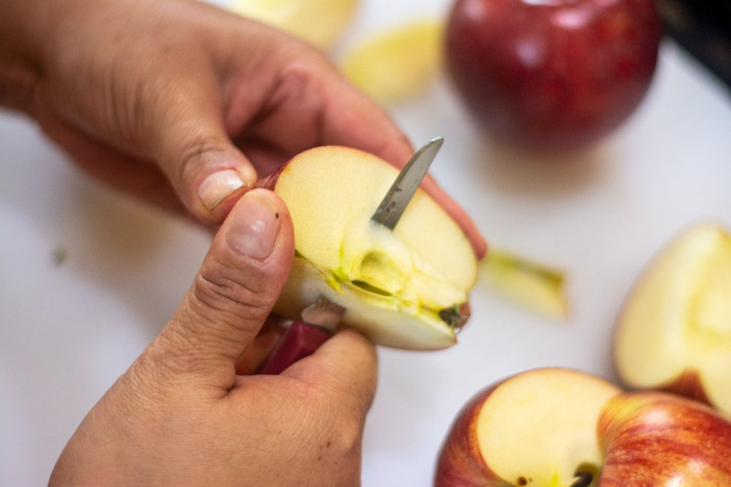 coring the apples with a small pairing knife and cut apples on a cutting baord