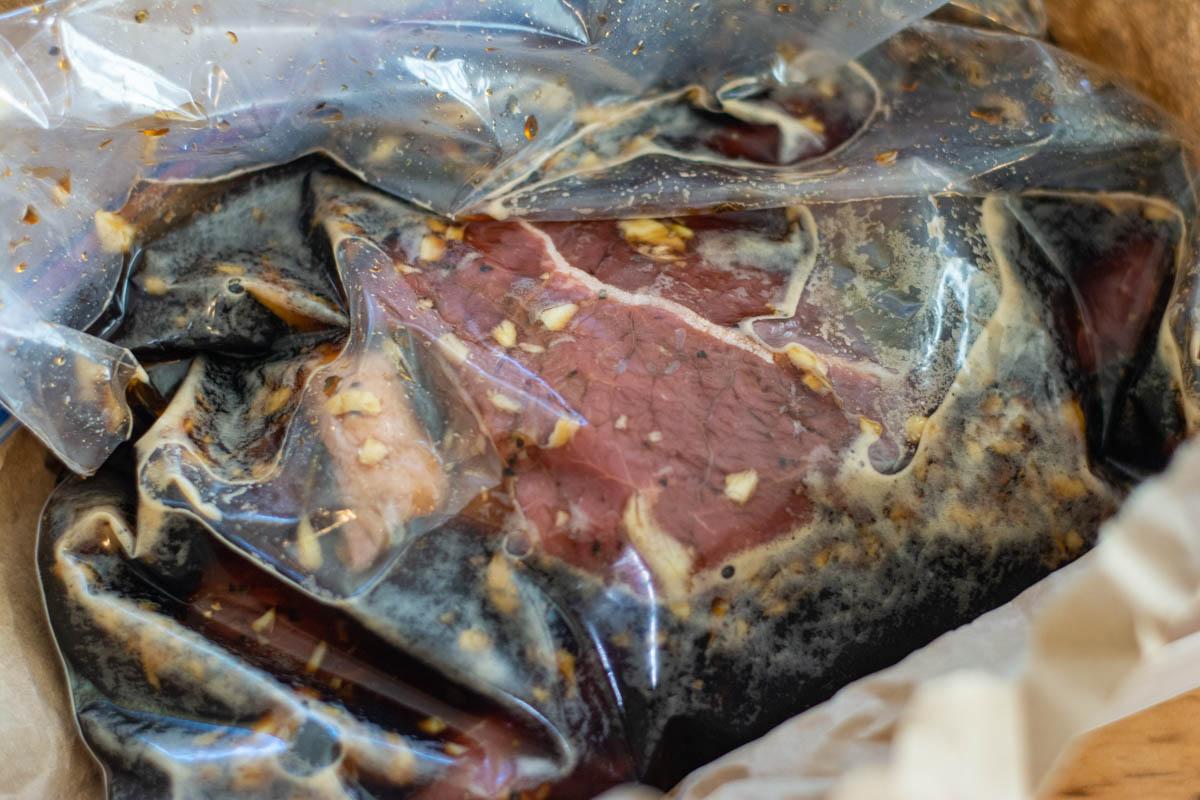 steak inside a Ziploc bag in the marinade