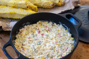 cast iron pan with the mixed beer corn dip and ready for cooking