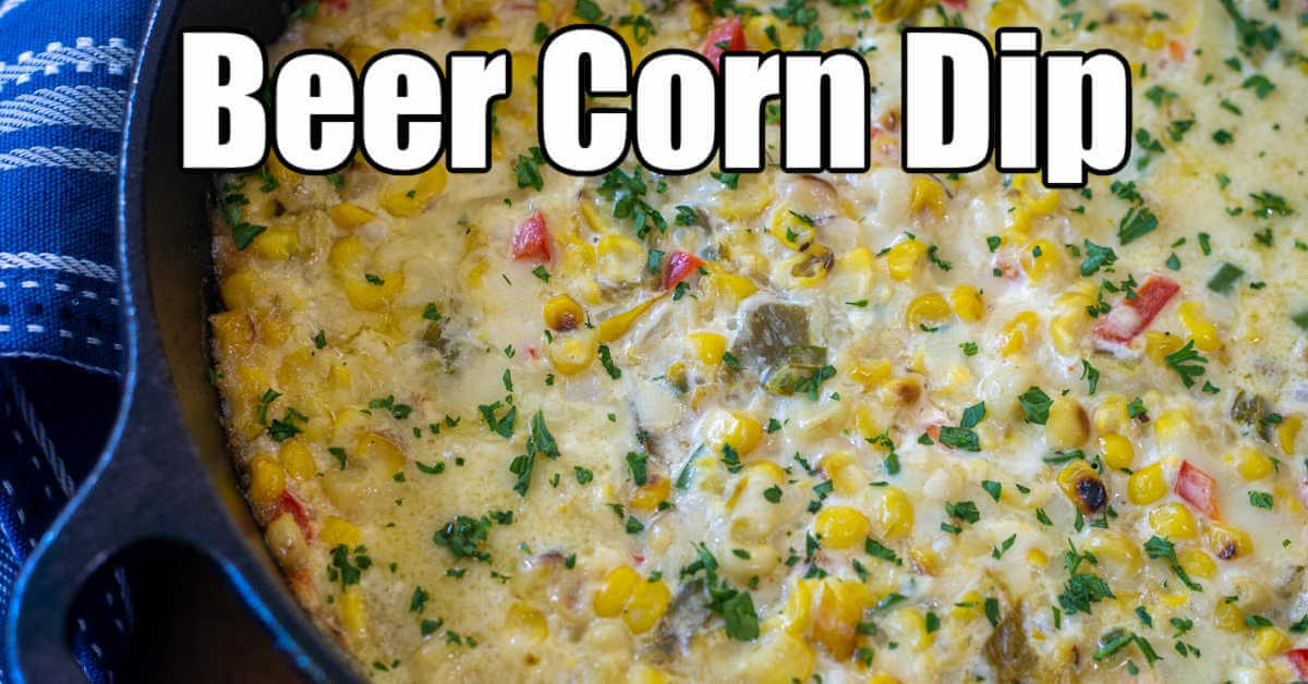 top down view of the beer corn crack dip sprinkled with chopped chives