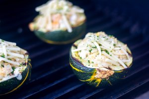 after filling with seafood, the squash is on the grill and sprinkled with a bit more cheese