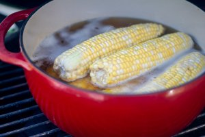 ears of corn in the dutch over on the grill