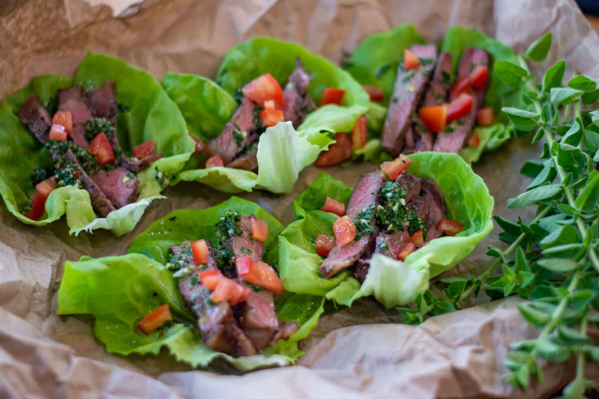 Sirloin in lettuce wraps with a teaspoon of Chimichurri on each