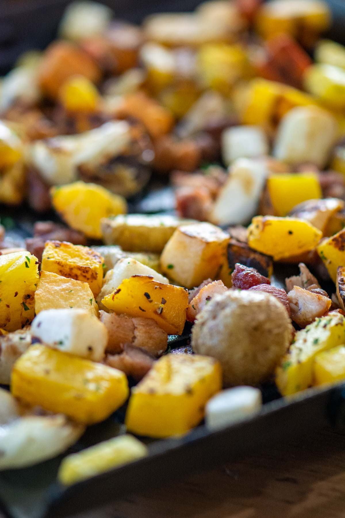 grilled roasted root veggies on a cast iron skillet.