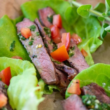 grilled sirloin on top of lettuce wraps with a teaspoon of fresh Chimichurri