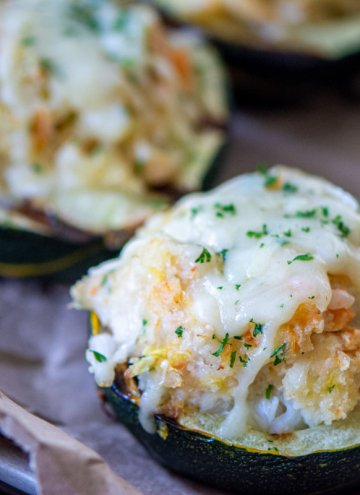 stuffed squash on a butcher paper lined sheet pan