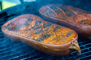 squash on the grill with smoke billowing