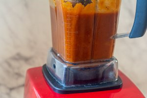 closeup of the Vitamix high speed blender with the sauce in it