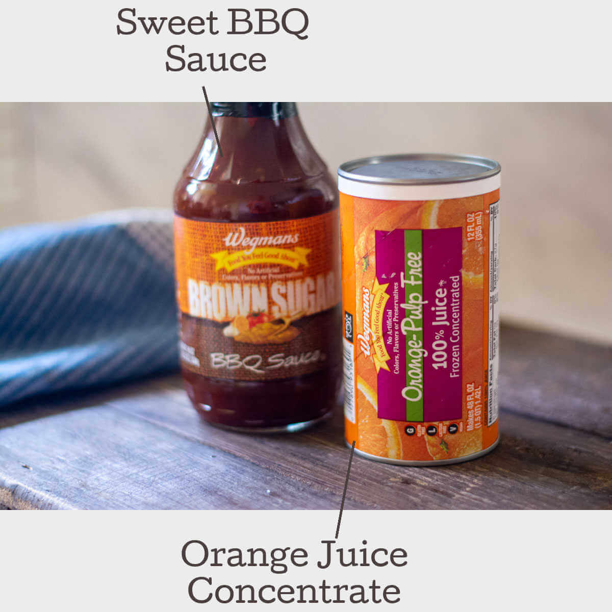 orange juice and BBQ sauce on a cutting board to show the ingredients.