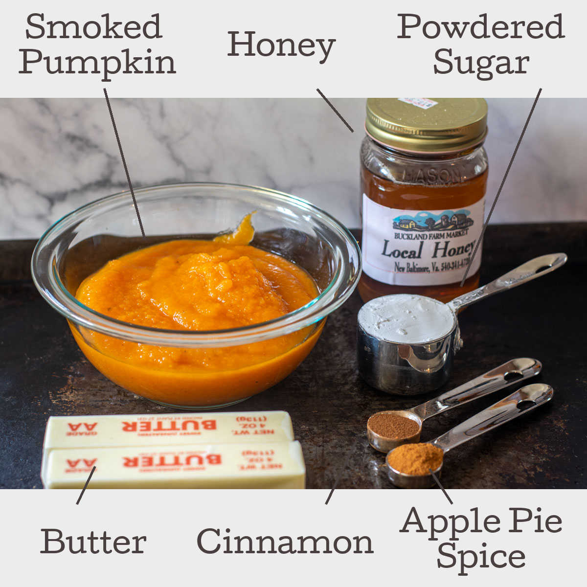 ingredients for smoked pumpkin butter laid out on a sheet pan with labels